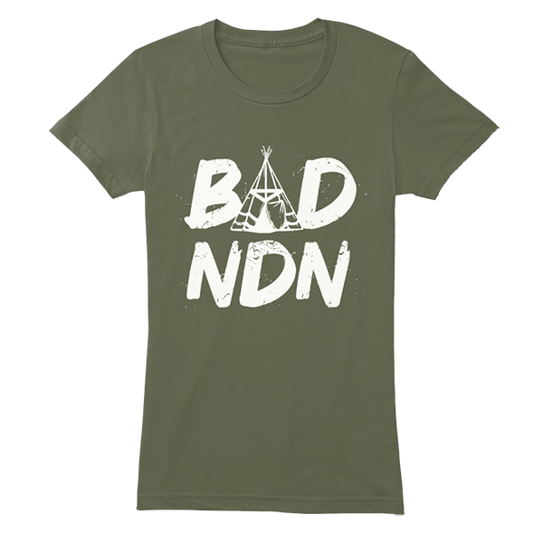A BAD NDN green tee shirt. The A in BAD is a Tipi.