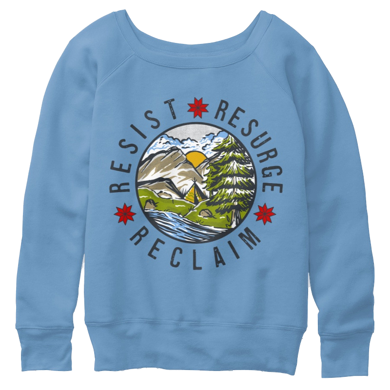 A blue women's slouchy sweatshirt with a round illustration of nature in the middle, containing the text Resist Resurge and Reclaim around it.